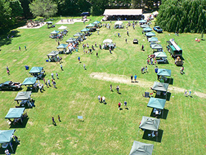 A_view_of_the_lineup_of_tree_festival_booths_at_Cranbury_Park. 2