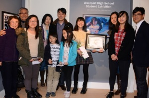 Audrey Seo (Grade 11, Staples High School) and her family next to her winning entry. Photo by Helen Klisser During.