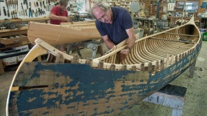Schuyler Thomson (foreground) of Norfolk Boatworks will be open on Station Place, Norfolk, Conn., to show visitors how a wooden canoe is constructed. He will also be working on building and restoring other boats during Weekend in Norfolk, August 5, 6 and 7. Photo © Bruce Frisch.